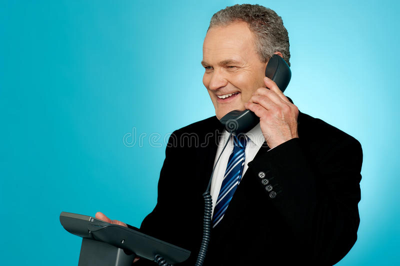 Senior manager discussing deal with client stock images