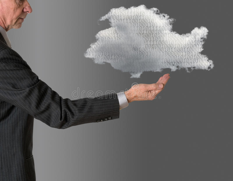 Senior manager with floating cloud computing. Senior male caucasian executive with floating cloud computing shape. Connection to electronic records via WiFi to royalty free stock image