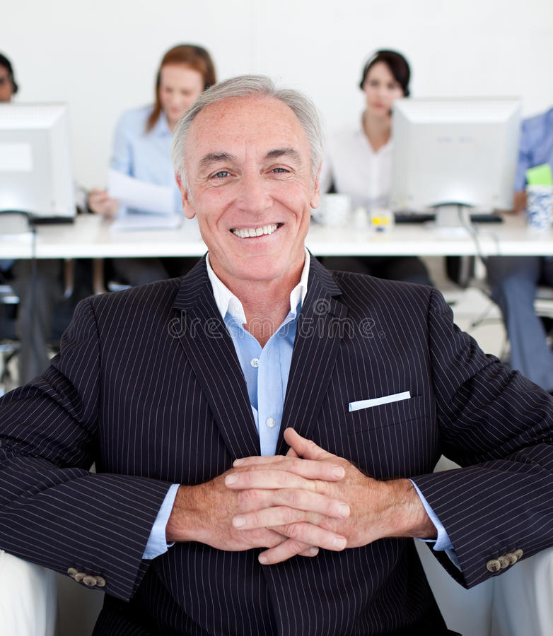Senior manager with his team in the background stock images
