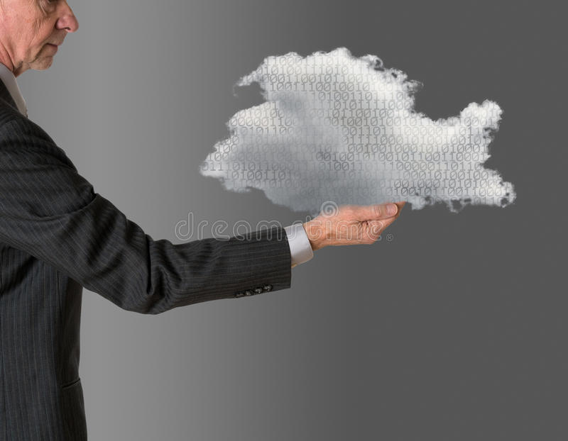 Senior manager holding cloud computing. Senior male caucasian executive holding cloud computing shape. Connection to electronic records via WiFi to web services royalty free stock photo