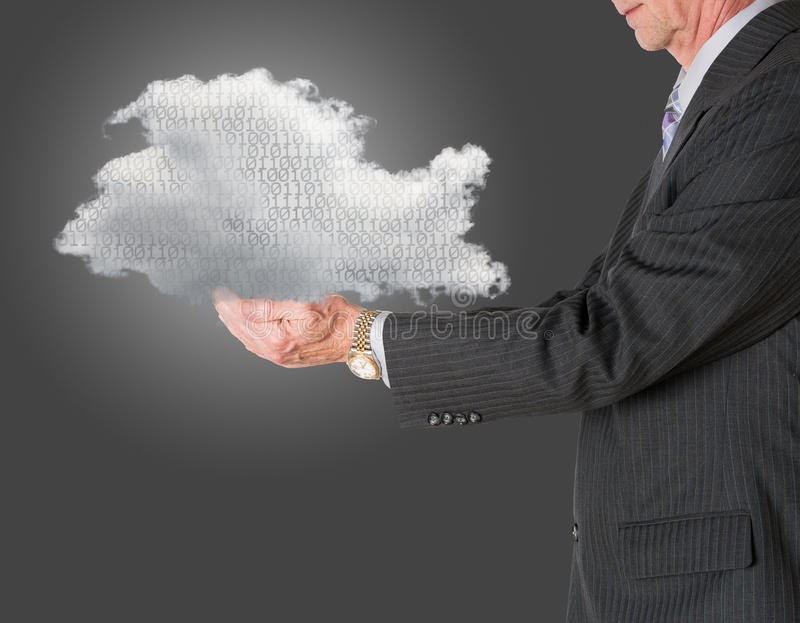 Senior manager holding cloud computing. Senior male caucasian executive holding cloud computing shape. Connection to electronic records via WiFi to web services stock images