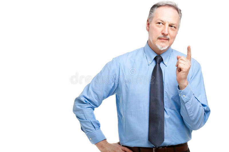 Senior manager pointing his finger up. Isolated on white royalty free stock photos