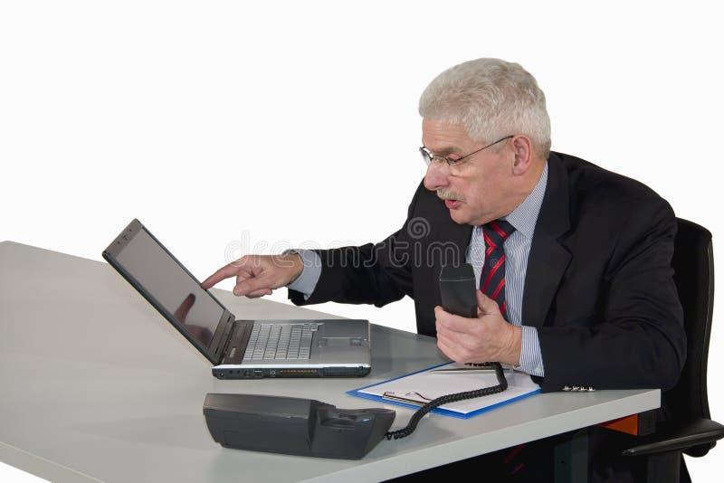 Senior manager pointing at laptop stock photos