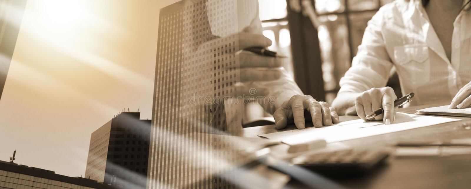 Senior manager working with executive assistant; multiple exposure stock photos