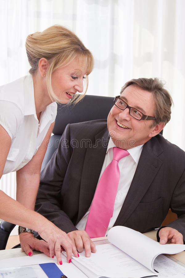 Download Senior Managing Director With His Secretary At Desk Stock Photo - Image: 36261630