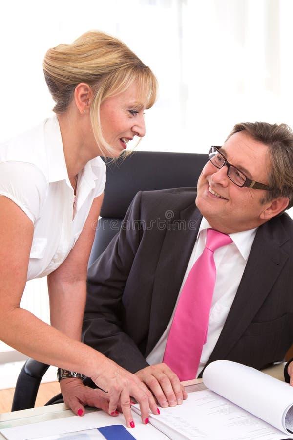 Senior Managing Director With His Secretary At Desk Stock Photos