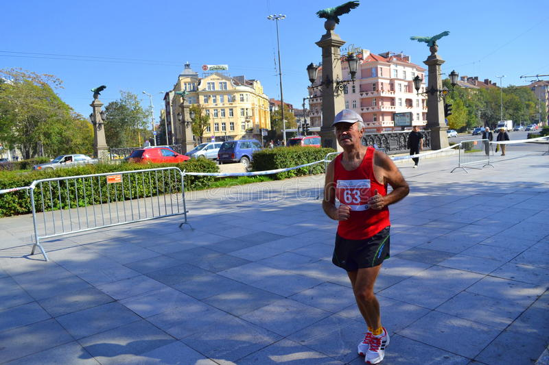 Senior marathoner Sofia Eagle Bridge. On October 12, 2014 in Sofia was held 31 International Marathon. The race started a total of 2,200 people, but at shorter royalty free stock photography