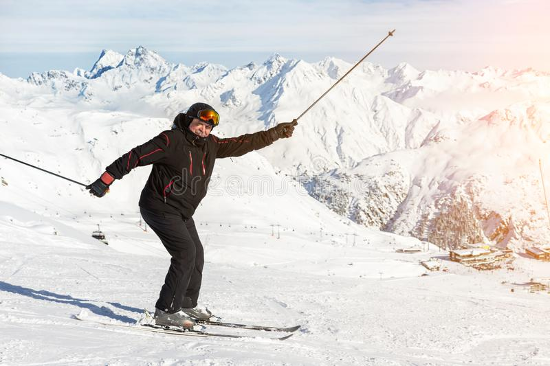 Senior mature happy funny skier having fun and fooling around at winter alpine skiing resort. Old aged sporty person. Enjoy vacation at mountain Alps snow slope stock images
