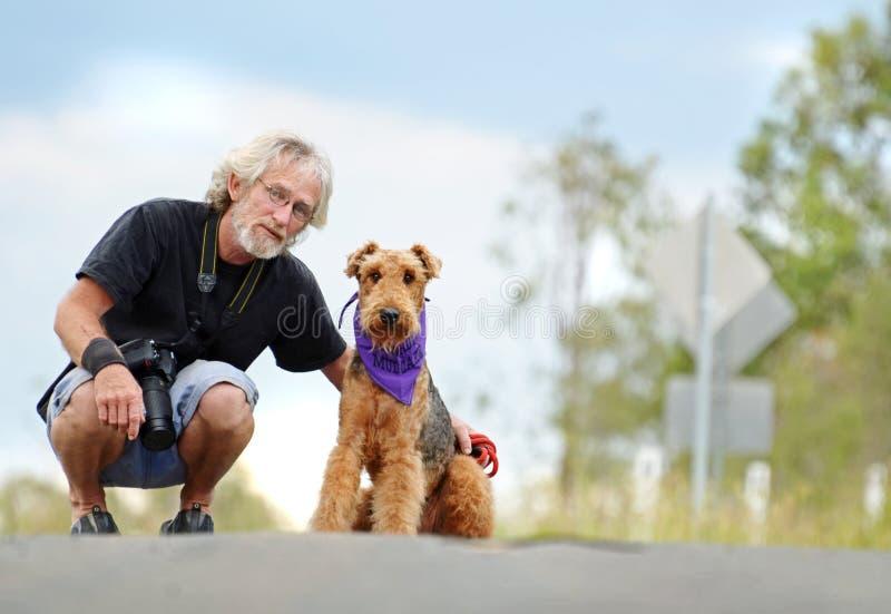 Senior mature man & pet dog on walk outdoors royalty free stock image