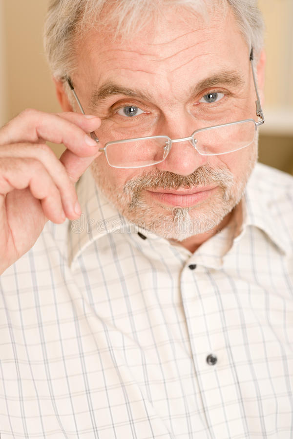 Senior mature man thoughtful with glasses stock photo