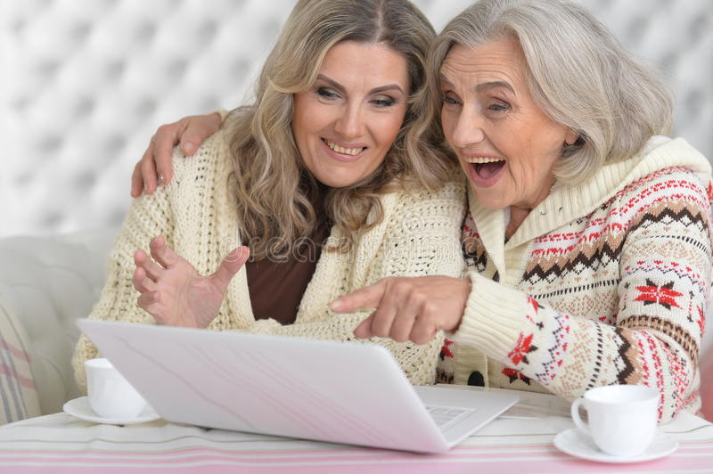 Senior and mature women. Portrait of senior and mature women with laptop stock images