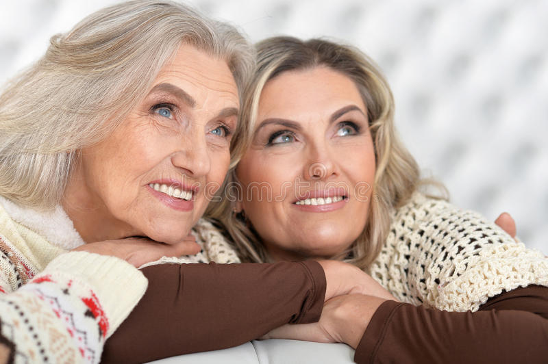 Senior and mature women. Portrait of two smiling senior and mature women looking at the distance royalty free stock images