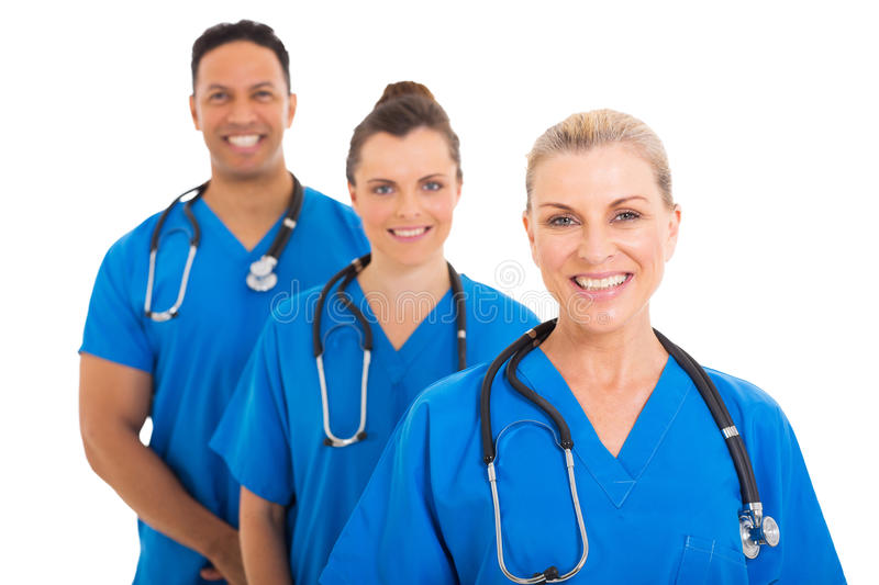 Senior medical colleagues. Confident senior medical doctor and colleagues royalty free stock photo