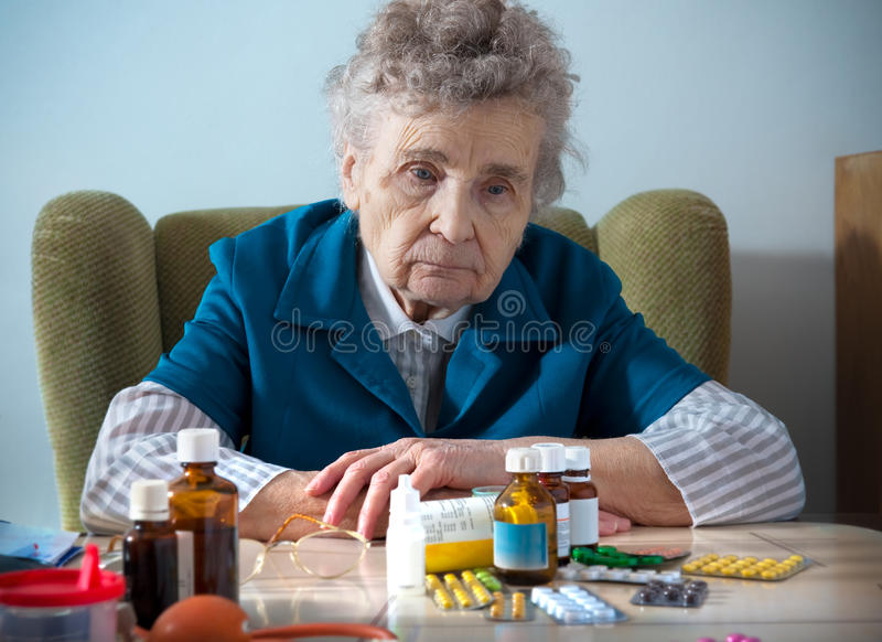 Senior and medicine royalty free stock photo