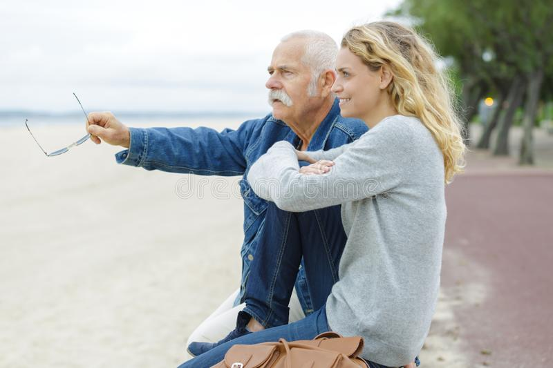 Senior man with adult daughter at sea royalty free stock photography