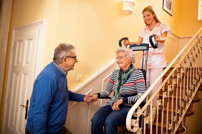 Senior man forgive with his wife while she goes to nursing home royalty free stock photos