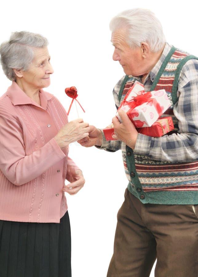 Senior men give gifts senior women stock photography