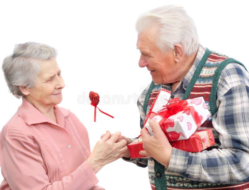 Senior men give gifts senior women stock photos