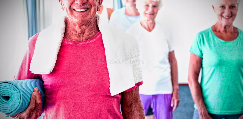 Senior man holding yoga mat stock image