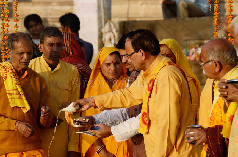 Senior men perform ritual ceremony at holy Pushkar Sarovar lake,Pushkar,India royalty free stock photography