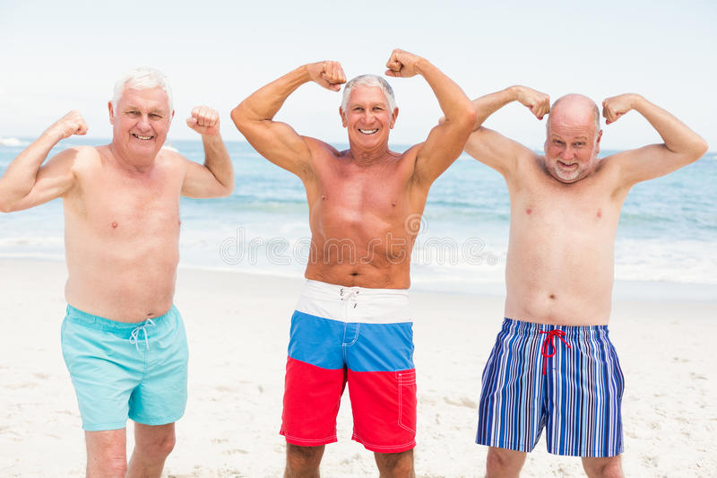 Senior men posing with their muscles. On a sunny day stock photos