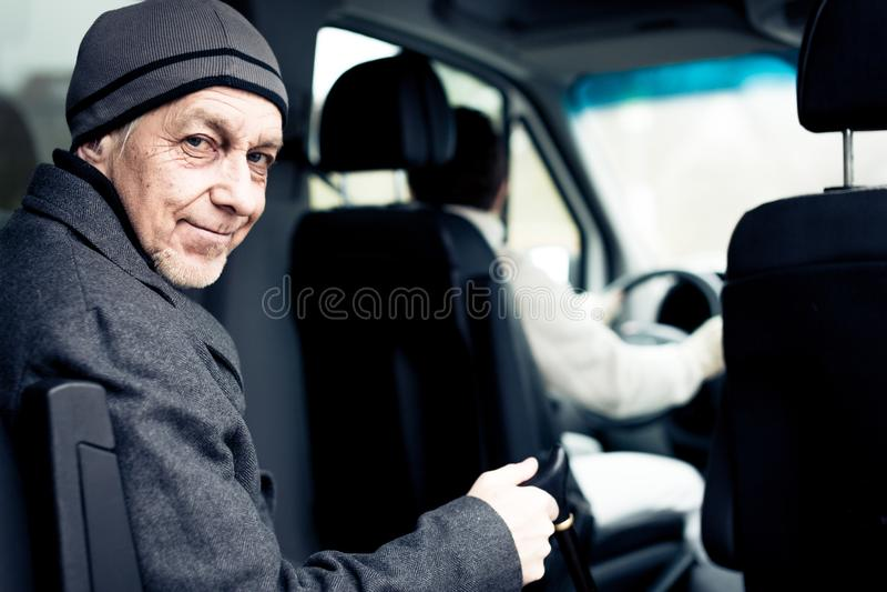 Senior Man Sitting In Paratransit Van stock image