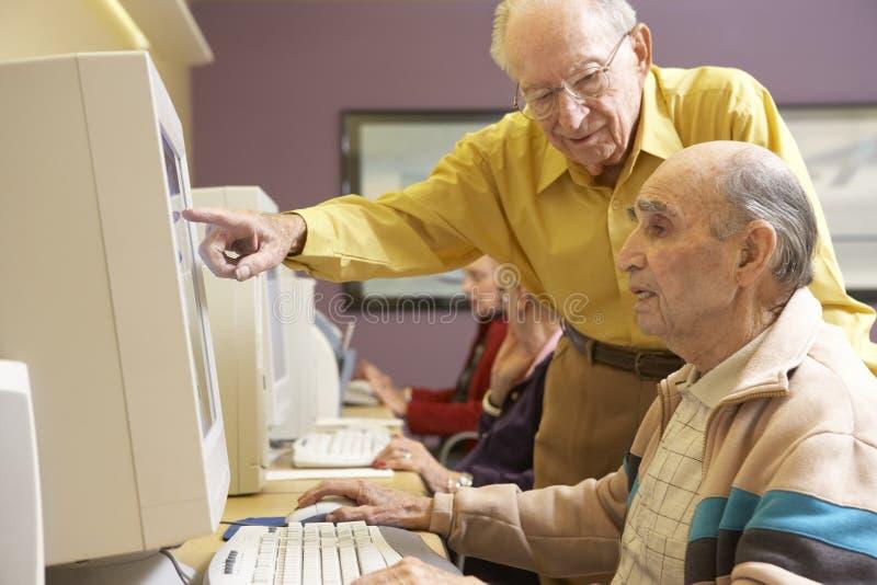 Senior men using computer royalty free stock photography