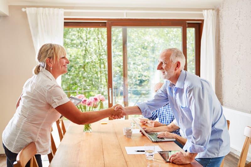 Senior man welcomes nursing wife royalty free stock photo