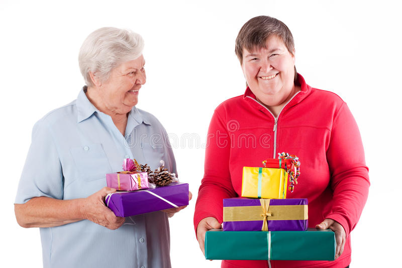 Download Senior And Mental Disabled Woman Holding Gift Stock Image - Image: 26718257