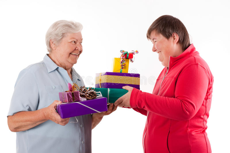 Senior And Mental Disabled Woman Holding Gifts Stock Photos