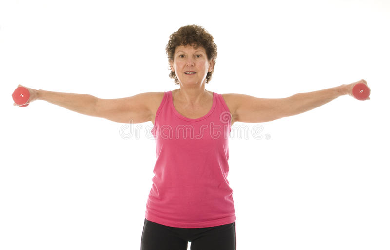 Senior middle age woman exercising with dumbbells royalty free stock photos