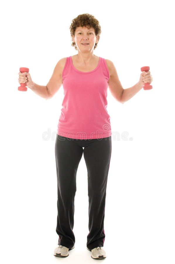 Senior middle age woman exercising with dumbbells stock photos