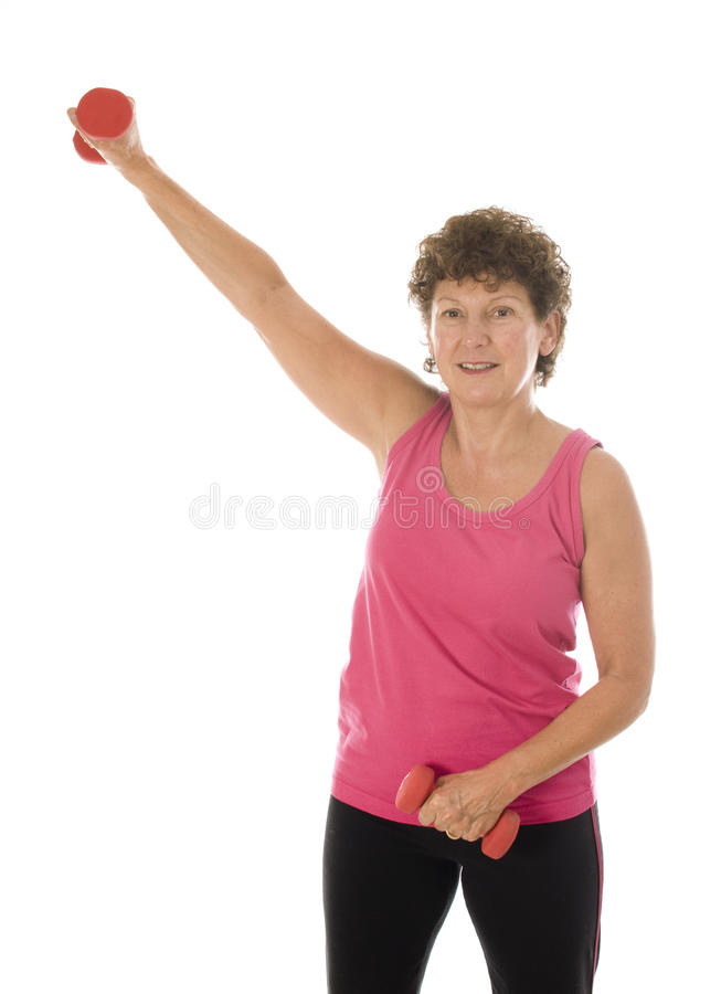 Senior middle age woman exercising with dumbbells royalty free stock photography