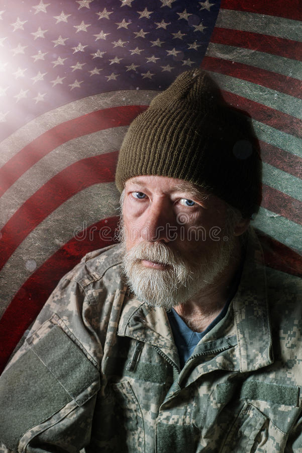 Senior military man in front of American flag. With a rough background royalty free stock image