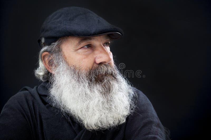 Senior mit vollem weißem Bart stockbild