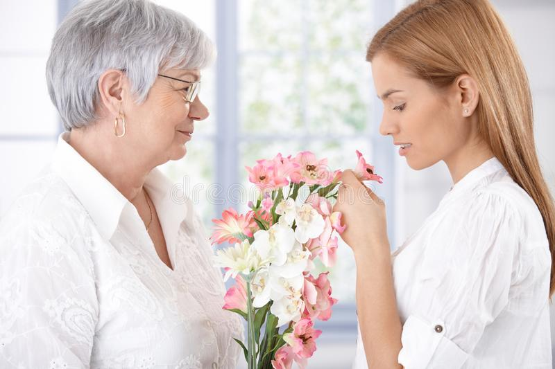Senior mother and daughter with flowers stock images