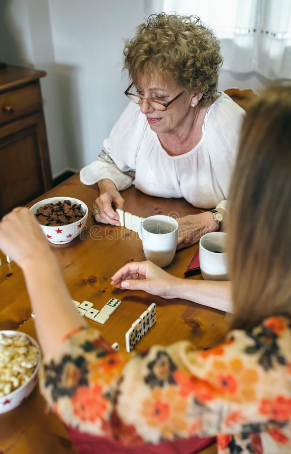 Senior mother and daughter playing domino royalty free stock images