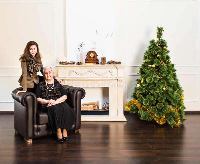 Senior mother and her adult daughter. Happy New Year party. royalty free stock images