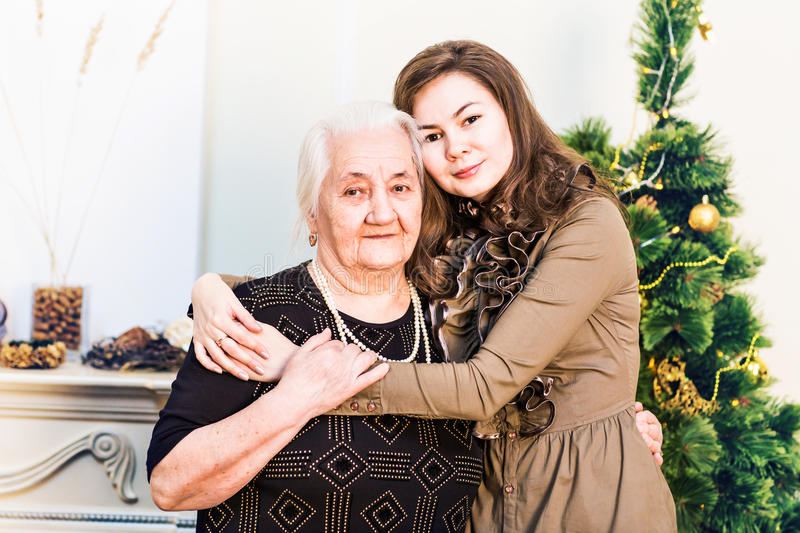 Senior mother and her adult daughter. Happy New Year party. royalty free stock image