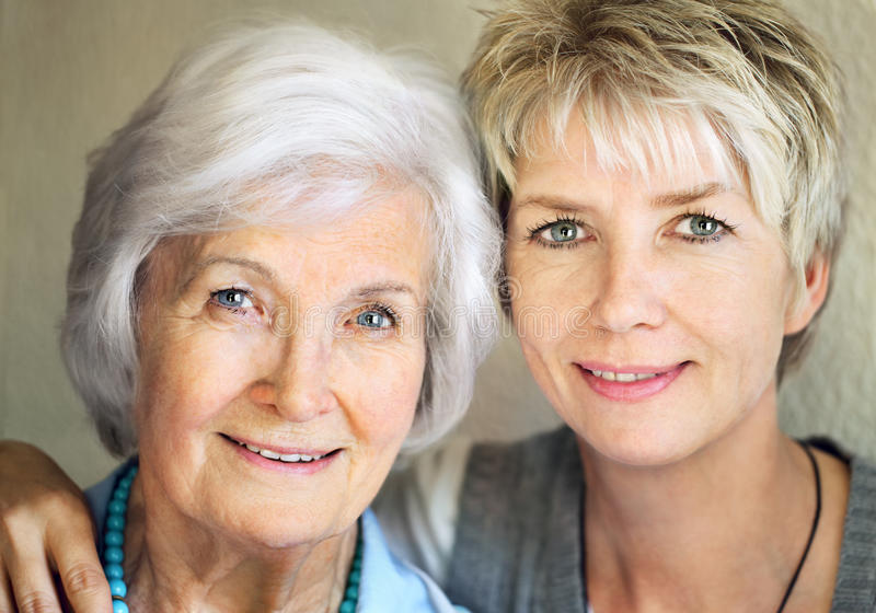 Senior mother and mature daughter royalty free stock photos