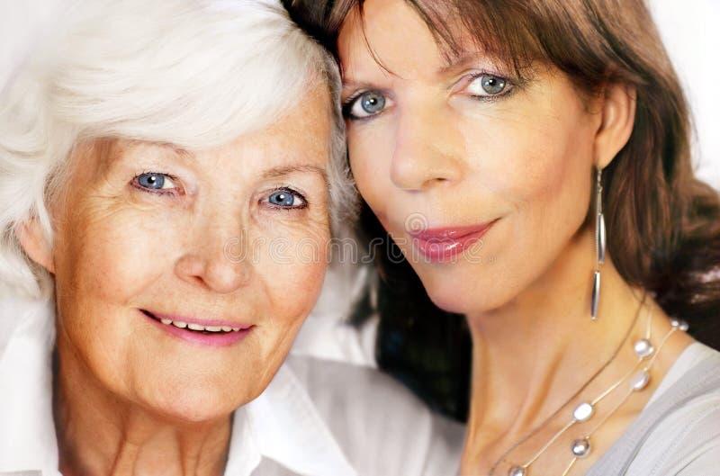 Senior mother and mature daughter stock photos