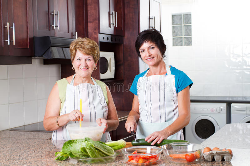 Senior mother and middle aged daughter stock photos