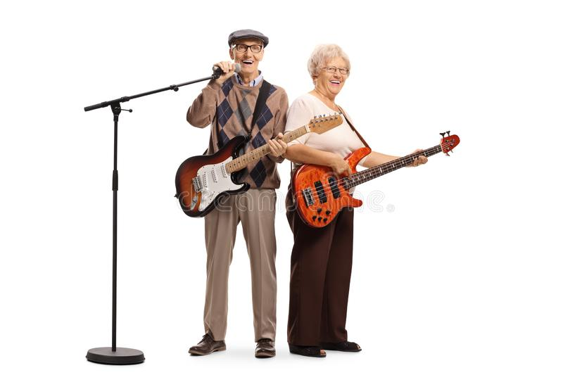 Senior musicians with electric guitar and a microphone. Full length portrait of senior musicians with electric guitar and a microphone  on white background stock images
