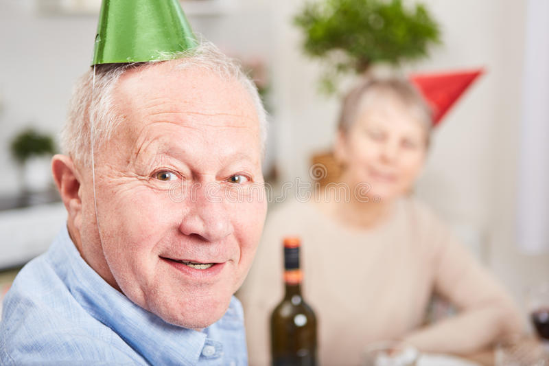 Senior in new year& x27;s eve celebration. With party hats royalty free stock photography