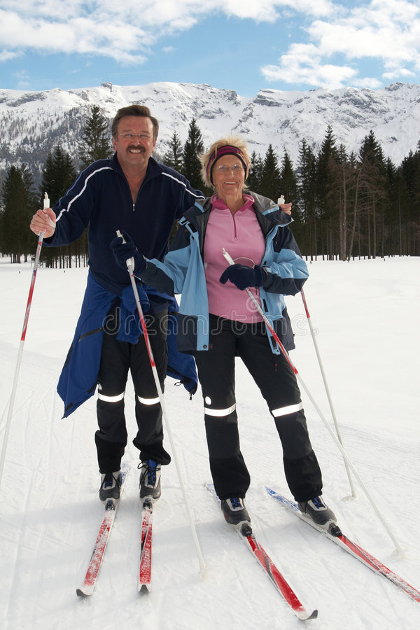 Senior nordic couple. A senior couple outdoor in a winter setting. The active couple is about to go crosscountry skiing stock photography