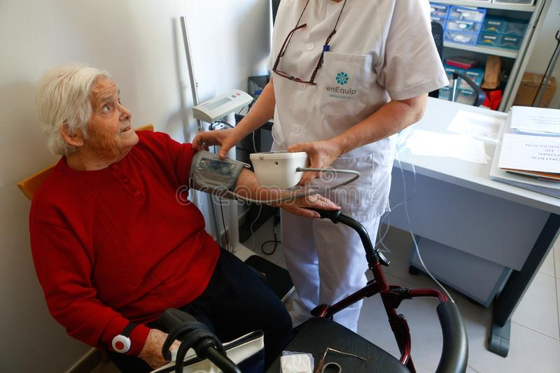 Senior with nurse on daily blood pressure control a nursing home in Mallorca stock images