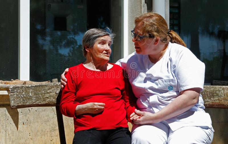 Senior with nurse on a nursing home in Mallorca royalty free stock images
