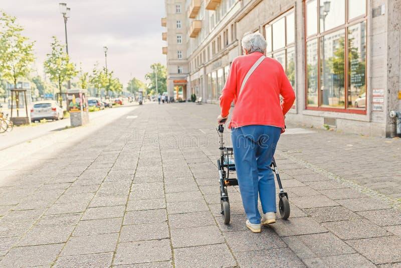 senior-old-woman-walking-alone-walker-city-street-elderly-disability-concept-senior-old-woman-walking-alone-174040122.jpg