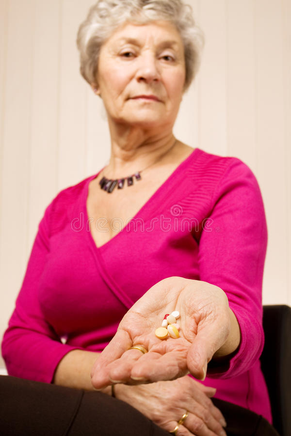 Download Senior Older Woman Holding Tablets Or Pills Stock Photo - Image: 13159754