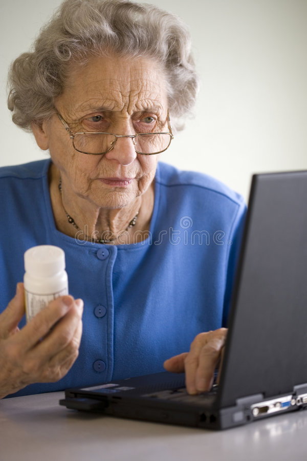 Senior ordering medication online royalty free stock photography